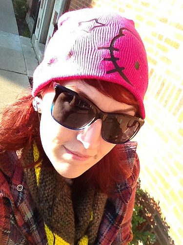 I take the bus to the train like a big girl in my Hello Kitty hat.